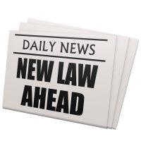 newspaper that reads new law ahead.jpg.crdownload